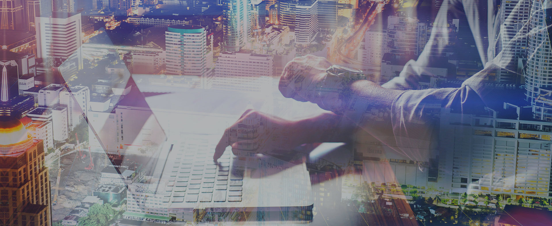 man using laptop and a city background
